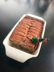 loaf of cranberry bread with a christmas knife