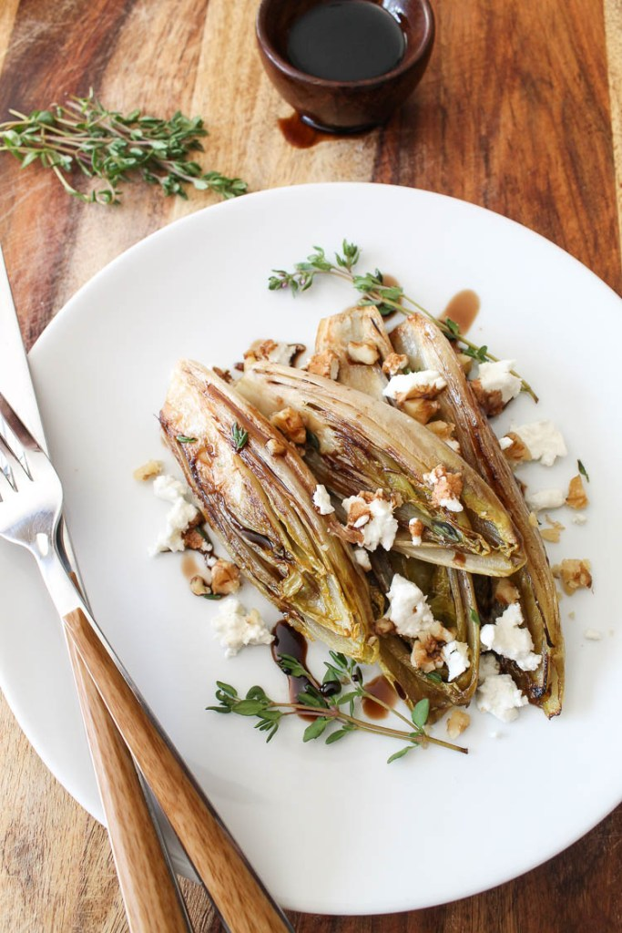 Sautéed Belgian endive halves with balsamic reduction, walnuts, and goat cheese.
