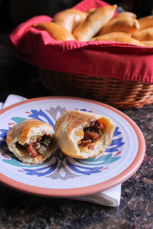 A great way to use up those Thanksgiving leftovers is to make empanadas. These empanadas are filled with ham and vegetables that have been seasoned with salsa negra and soy sauce. They go great with leftover cranberry sauce, too!