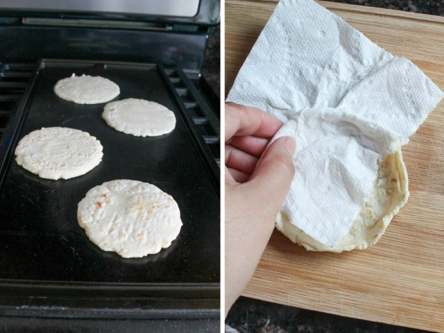Masa discs cooking on a warm griddle then pinched at the edges to create a wall around the discs.