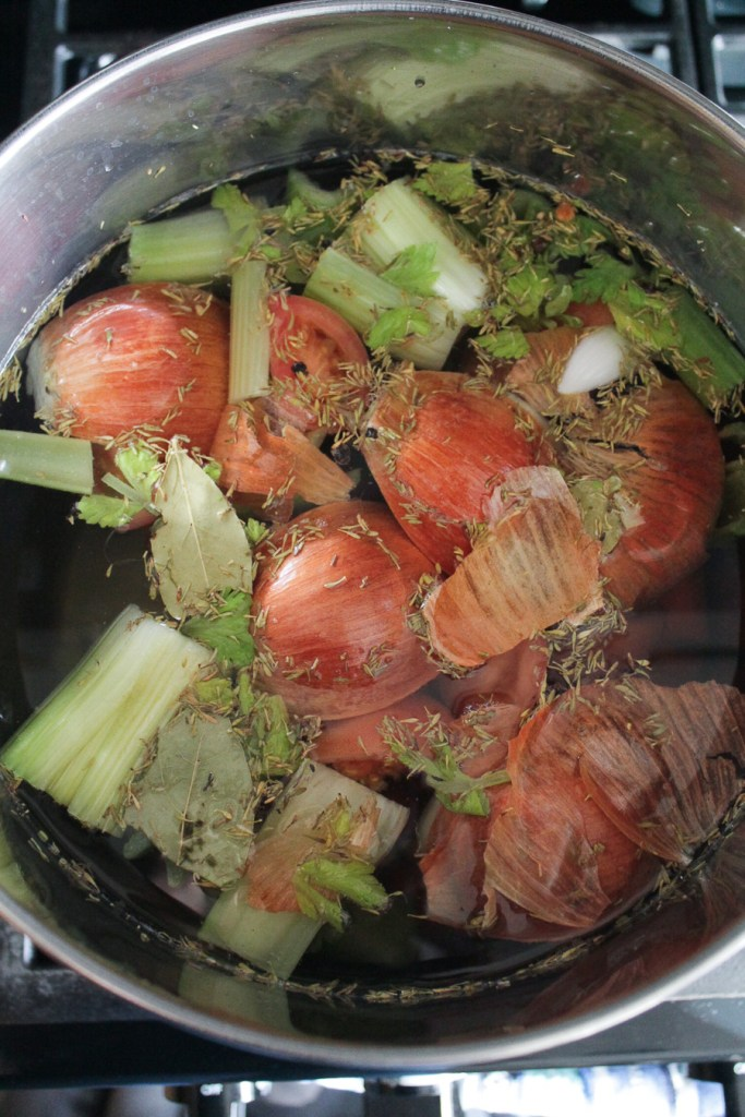 Vegetables boiling in a pot to make vegetable broth.