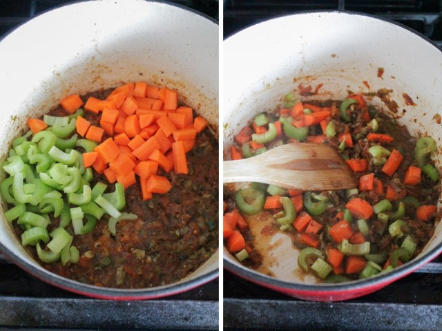 Chopped carrots and chopped celery being added to a pot of soup.