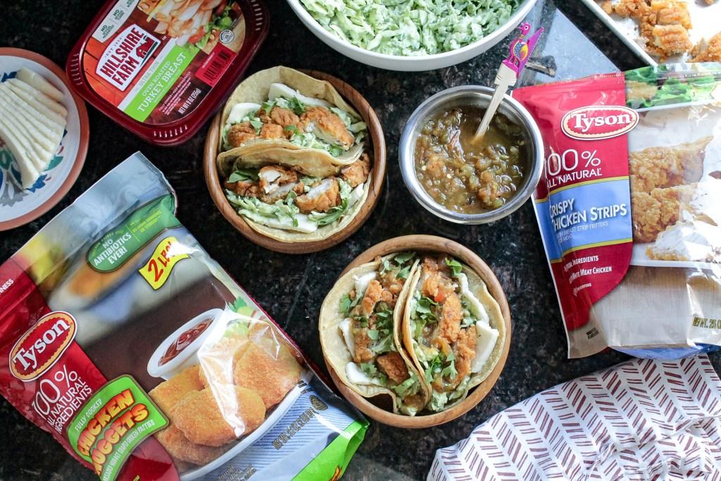 Crispy Chicken tacos in corn tortillas with creamy avocado slaw recipe