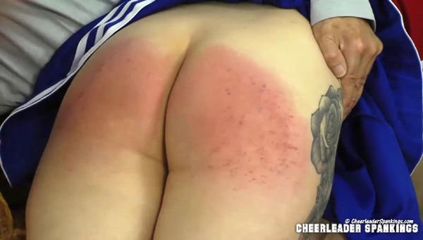 Katie's bottom gets very red after her third humiliating spanking of the day