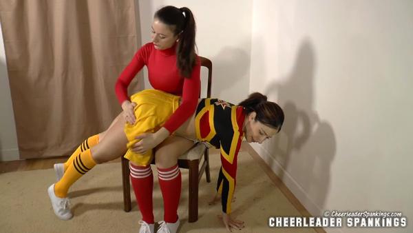 Cheerleader Jordana Leigh gets spanked OTK by Sarah Gregory