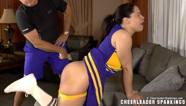 Mackenzie bends over for a hard strapping with a large leather strap