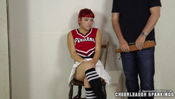 Rosie Ann prepares for her initiation in Welcome to the Team at Cheerleader Spankings