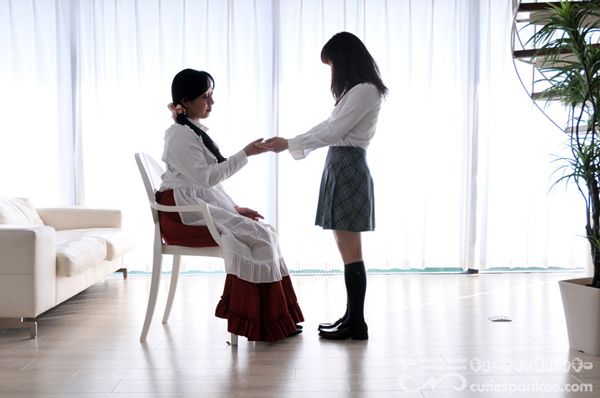 Submissive schoolgirl hands a paddle to her mother