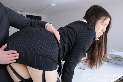 Monthly work review ends up in a spanking for sexy office worker