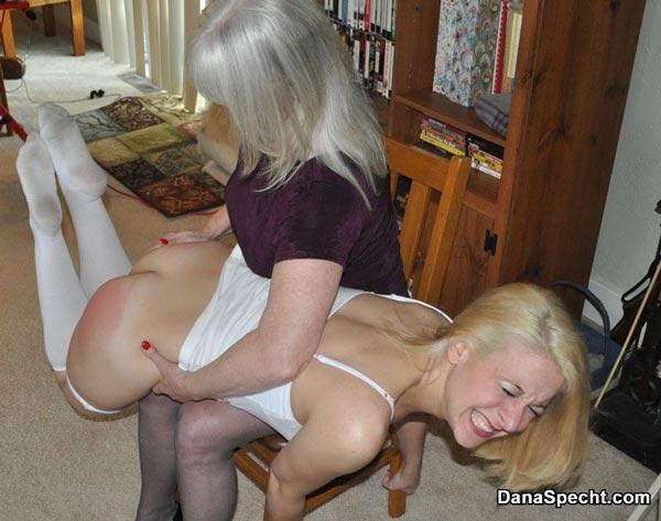 Strict mom Dana Specht spanks Sarah Gregory with her hand OTK