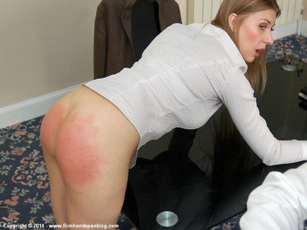 Belinda Lawson sticks her bare bottom out and awaits the next stroke of the belt