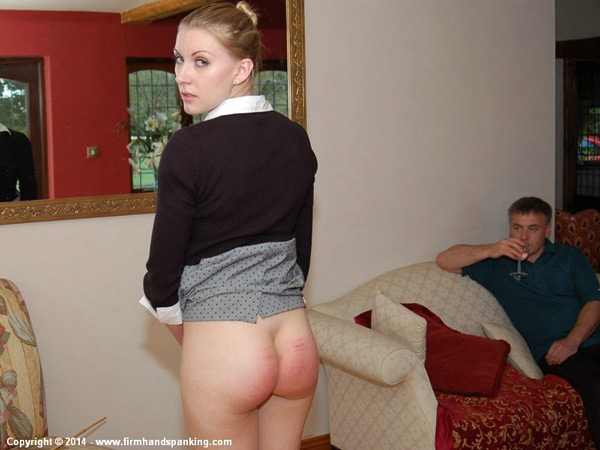 Belinda Lawson shows off her striped bare bottom after her caning