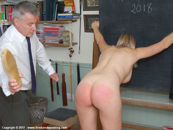 Belinda Lawson bends over nude in the classroom for the slipper to the chimes of Big Ben