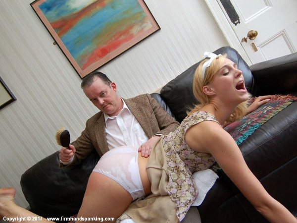 Amelia Jane Rutherford gets spanked OTK over panties with a wooden hairbrush