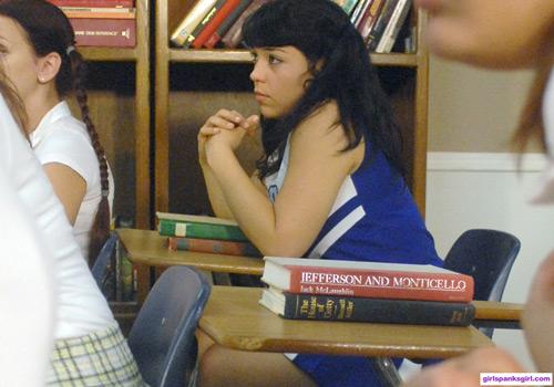 Cheerleader Lilia Spinoza sits at the back of the classroom
