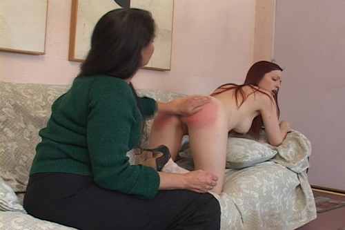 Molly's sexy, round bottom gets spanked til it's very red indeed