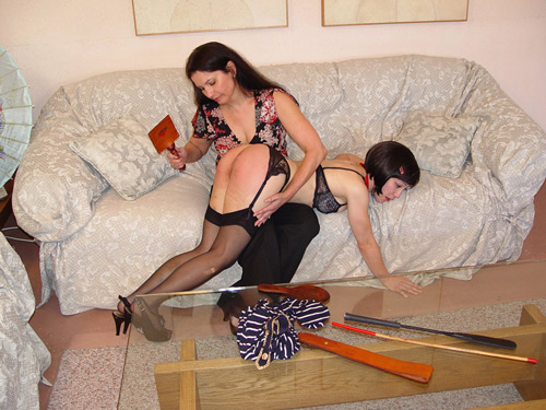Pretty and petite Mei Mara gets spanked by Chelsea Pfeiffer in her sexy stockings