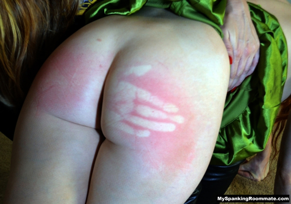 Veronica Ricci's hard spanking produces a very bright and vivid handprint on her ass