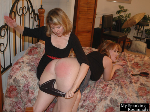 Julie's grin soon turns into a grimace as Clare continues to spank her big, bare bottom