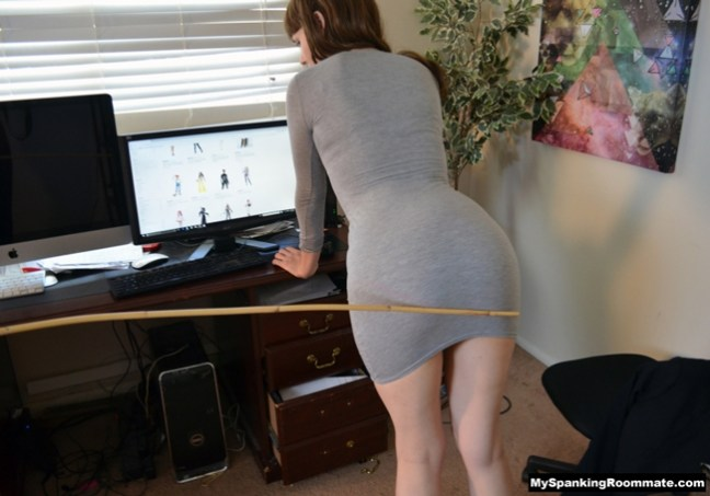 Linny Lace bends over the desk for a caning over her dress