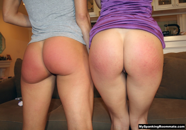 Two pretty models compare their spanked rears