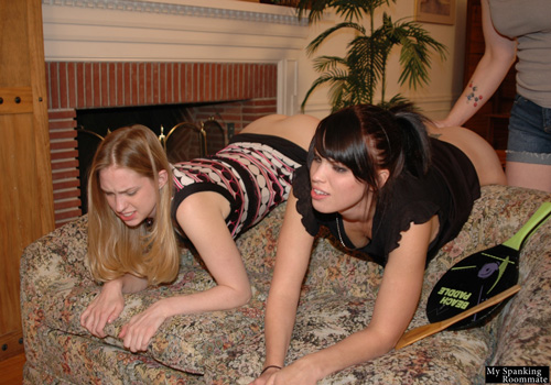 Kailee and Chloe Elise bend over the back of the sofa to be spanked side-by-side