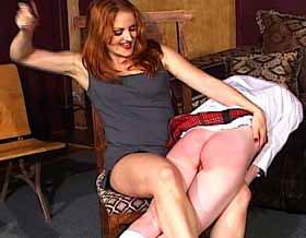 Mistress Gemini really enjoys her work as she spanks a naughty bare bottom