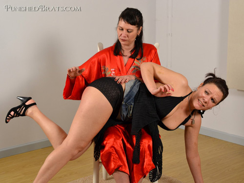 Naughty Audrey gets her plump bottom spanked over her mom's knee