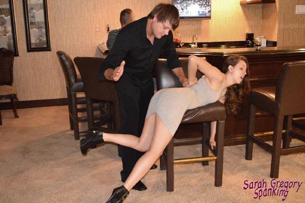 Johnny spanks naughty Joelle over the bar stool
