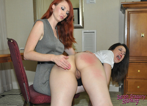 Sarah gets a hard hand spanking on her bare bottom over Kendra's knee