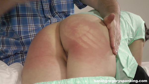 Casey Calvert gets a handprint on her sore red bare bottom during her punishment
