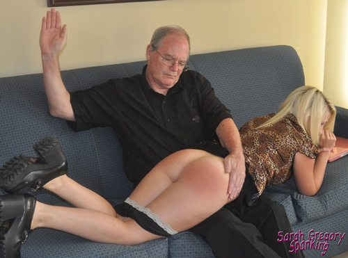 Paul gives Kat St James a hard OTK spanking on her bare bottom then reaches for the hairbrush