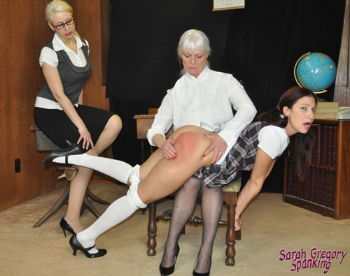 Schoolgirl Scarlet Summers gets her bare bottom spanked over the Principal's knee