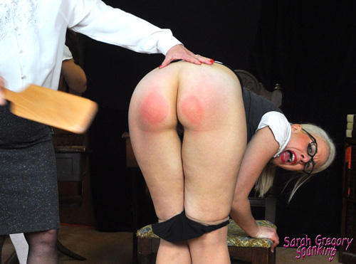 New teacher Sarah Gregory gets a taste of the Principal's paddle