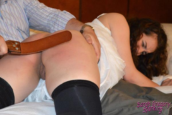 John punishes Angel Lee with the leather strap for spanking Sarah too much