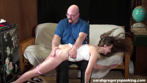 The hard hand spanking continues for a long time on Joelle Barros's naughty bottom