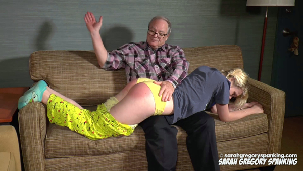 Paul Rogers spanks daughter Quinn over her pajamas over his knee