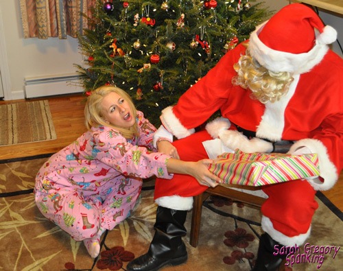 Sarah Gregory tries to rescue her presents back from Santa