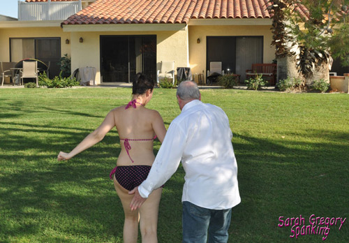 Sarah gets her wet bottom whacked as she's led into the house