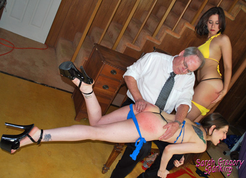 Sarah Gregory faces the wall with a sore bottom while Theresa takes her turn over the knee