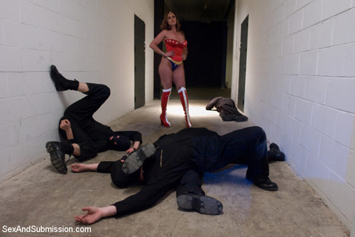 Busty Super Heroine Christina Carter breaks into the facility