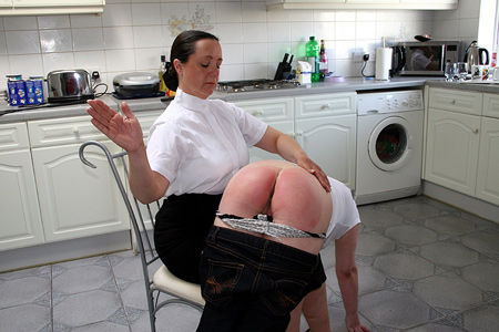 Girl gets her bottom bared for a beautiful hard OTK in the kitchen