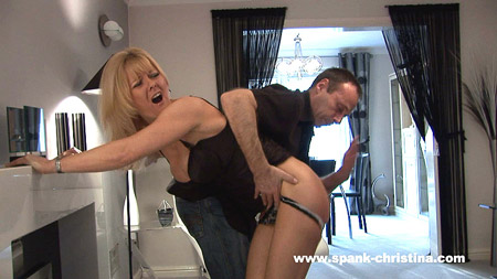 Samantha has her dress hitched up and her knickers pulled down for her bare bottom spanking