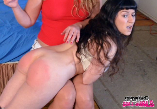 Elori Stix gets spanked OTK on her bare bottom by Mia Vallis