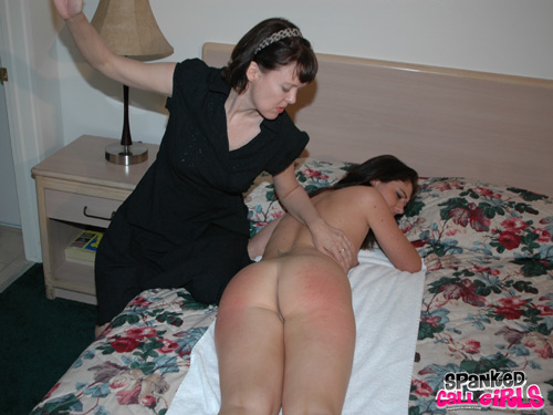 Katie Angel is spanked lying on the bed on a towel