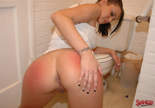 Alexis Grace examines her sore, red bottom on the bathroom floor