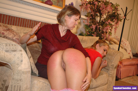 Clare spanking Alanah Rae over the knee
