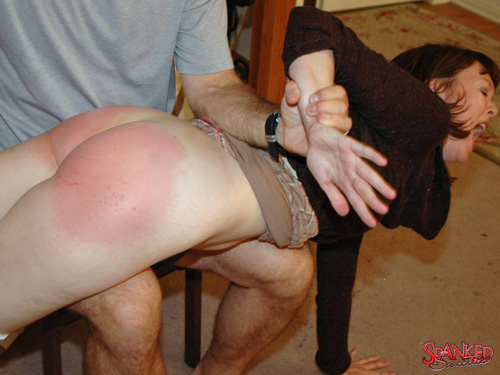 Clare Fonda's bottom gets very red as her bare bottom gets spanked hard