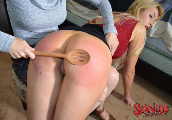 Gigi Allens gets a bare bottom spanking with a long, wooden spoon