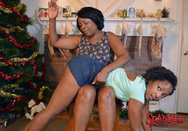 Slim ebony beauty Ivy Sherwood spanked by Mom OTK over denim hotpants